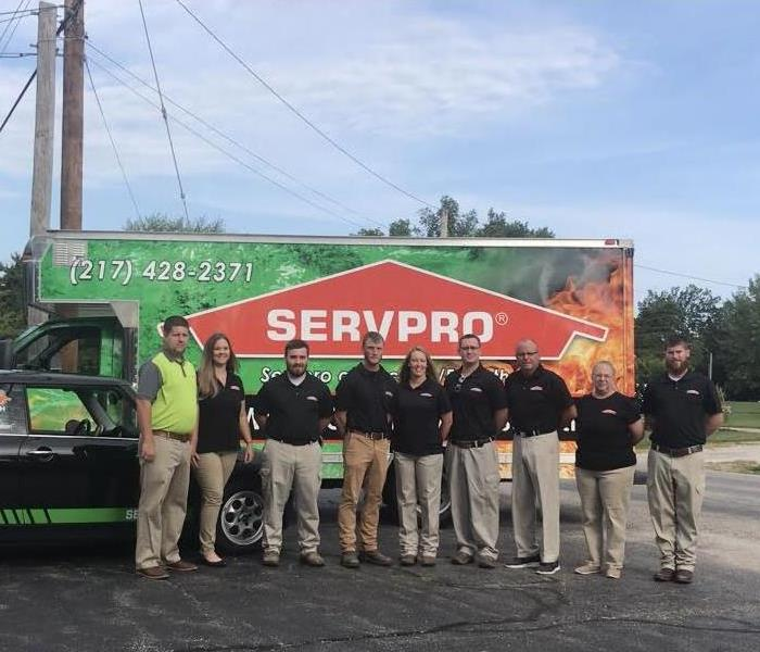 SERVPRO vehicle with team standing in front