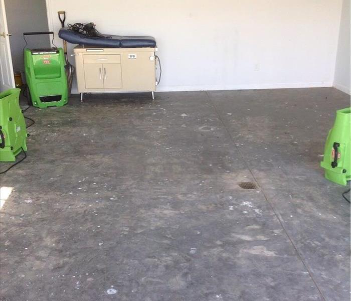 Basement floor with drying equipment.
